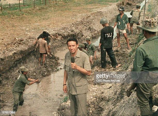 American TV news correspondent Mike Wallace of CBS News reports from a trench during the Vietnam War 1967