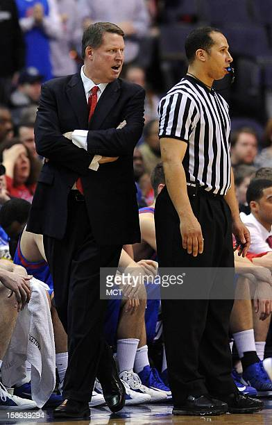 American University head coach Jeff Jones complains to a referee during the second half against Georgetown at the Verizon Center in Washington DC...