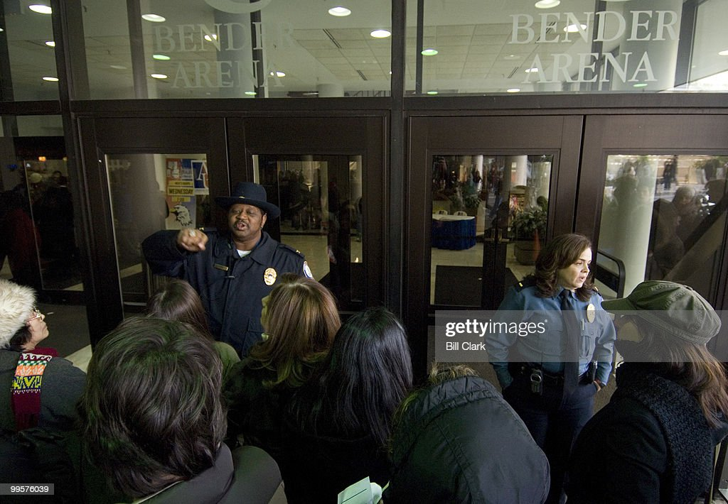 American University Police ask Barack Obama supporters to move away from the entrance to Bender Arena after the faciloity had reached capacity for the Obama campaign rally at American University on Jan. 28, 2008. The event was held for Sen. Edward Kennedy to deliver his endorsement to Obama.