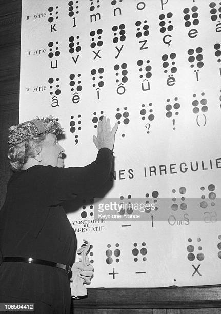 American University Student Helen Keller Blind Deaf And Dumb Stands Before A Frame With The 64 Basic Symbols For The Braille Writing System In French...