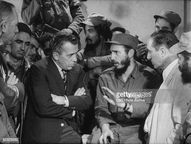 American variety show host Ed Sullivan interviews Cuban Communist leader and president Fidel Castro amid a group of uniformed revolutionaries on a...