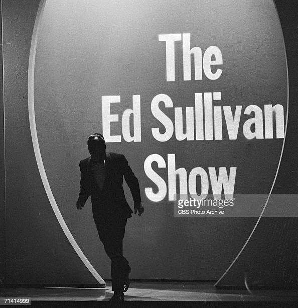 American variety show host Ed Sullivan makes his entrance, from the shadows, to the stage of his CBS program, 'The Ed Sullivan Show,' New York,...