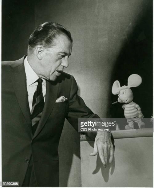 American variety show host Ed Sullivan talks to puppet Topo Gigio on 'The Ed Sullivan Show' October 4 1964