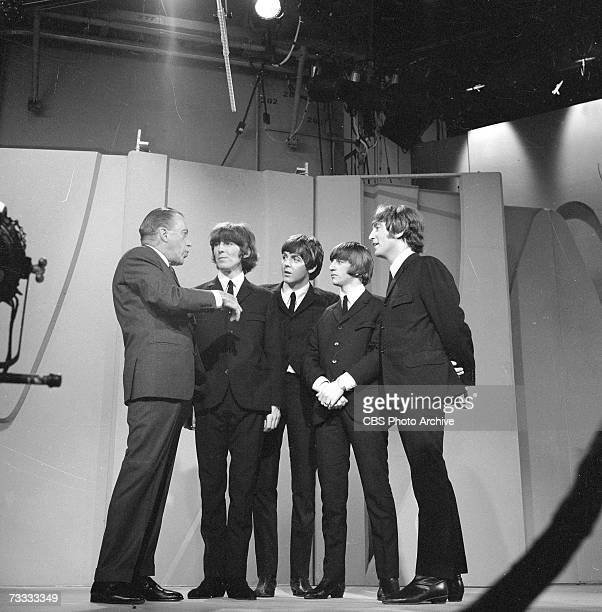 American variety show host Ed Sullivan talks with members of the British popular rock and roll band The Beatles George Harrison Paul McCartney Ringo...