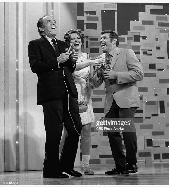 American variety show host Ed Sullivan throws his head back in laughter with comedy team Stiller Meara New York New York June 15 1969