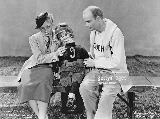 American ventriloquist Edgar Bergen performing with his dummy Charlie McCarthy wearing a football uniform in 1935