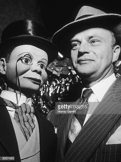 American ventriloquist Edgar Bergen poses with his creation dummy Charlie McCarthy at the Santa Claus Lane Parade Hollywood California McCarthy wears...