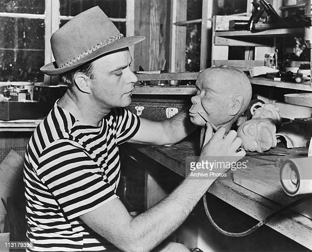 American ventriloquist Edgar Bergen working on one of his dummies in the 1950's