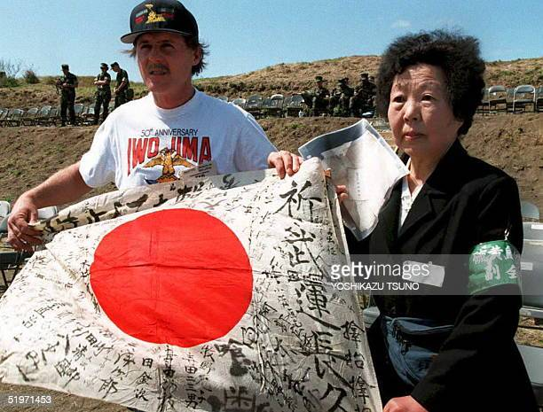 American veteran Theodore Fiedler returns a Japanese flag 14 March which was signed by Japanese Imperial Army soldiers during WWII to Yoshie Nakane a...
