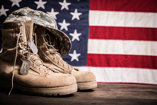 American Veteran's Day theme with military boots, hat, USA flag. 1041861964