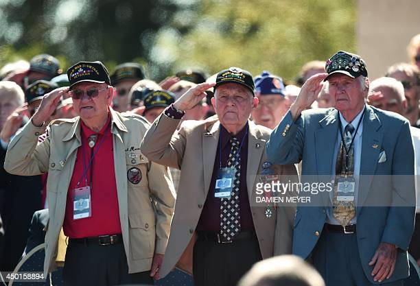American veterans salute during a joint FrenchUS DDay commemoration ceremony at the Normandy American Cemetery and Memorial in Collevillesurmer...