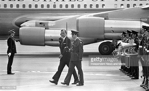 American vice President George Bush inspects a guard of honour upon his arrival at Dublin Airport