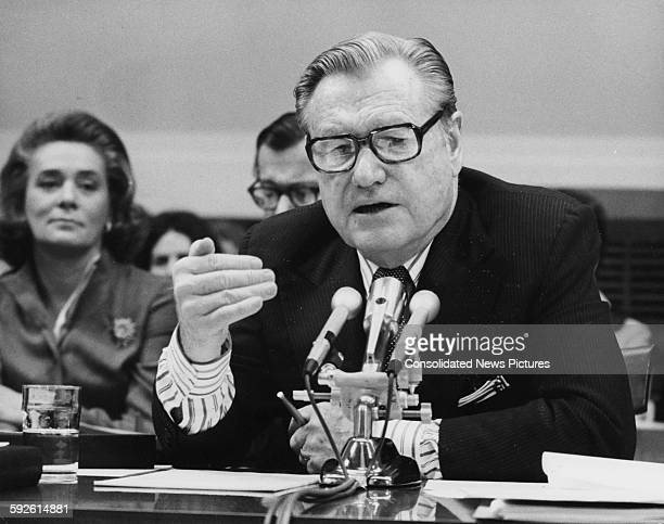 American Vice Presidential candidate Nelson Rockefeller with his wife 'Happy' sitting behind him speaking to the House Judiciary Committee Washington...