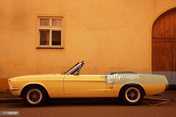 american vintage car on street - convertible stock pictures, royalty-free photos & images