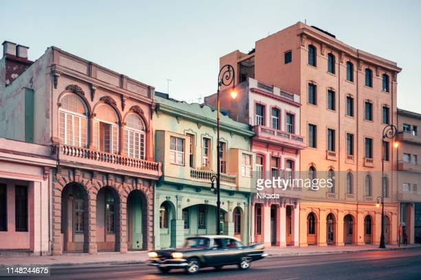 american vintage car speeding along the malecon in havana, cuba - 1960 stock pictures, royalty-free photos & images
