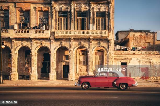 American vintage car speeding along the Malecon in Havana, Cuba