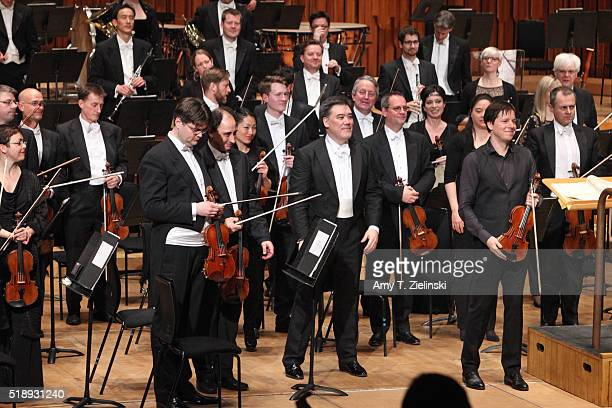 American violinist Joshua Bell receives the audience after playing the Tchaikovsky Violin Concerto with American conductor Alan Gilbert leading the...