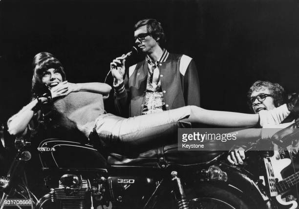 American vocal duo The Carpenters brother and sister Richard and Karen Carpenter in concert with a Honda motorcycle as a prop during their UK tour...