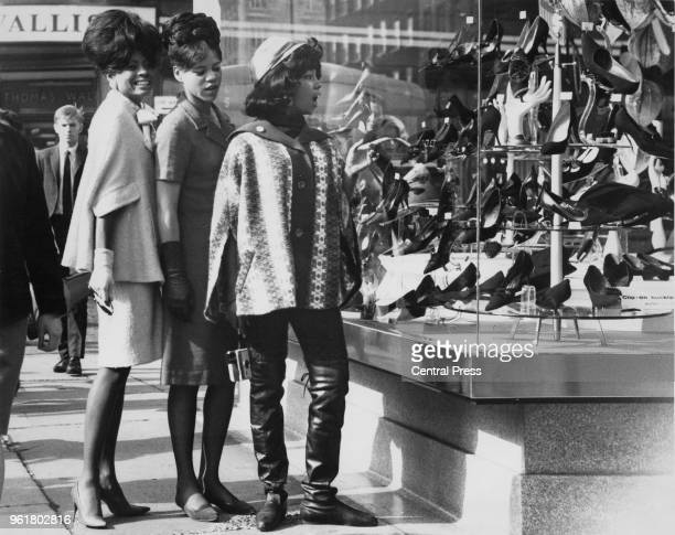 American vocal group The Supremes out shopping in Oxford Street during a visit to London 6th October 1964 From left to right they are Mary Wilson...
