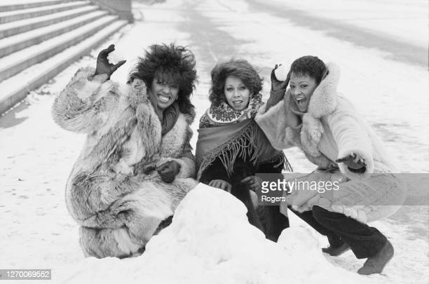 American vocal group the Three Degrees pose in the snow near the Royal Albert Hall in London, UK, 18th January 1985. From left to right, they are...