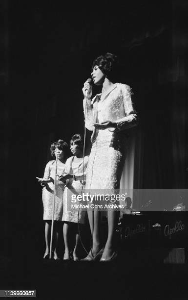 American vocal group the Vandellas, fronted by singer Martha Reeves, perform at the Apollo Theater in New York City, circa 1963.
