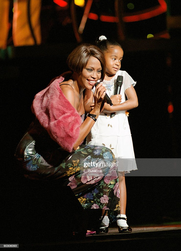 Whitney Houston with her daughter Bobbi Kristina Brown onstage during a concert on July 16, 1999 in New York City.