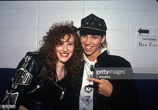 American vocalists Tiffany and Debbie Gibson pose backstage after a New Kids on the Block concert circa 1989