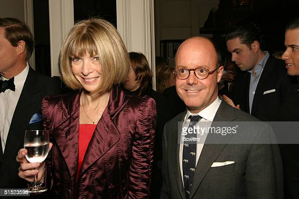 American Vogue Editor Anna Wintour and Robert Burke pose at the book launch party for 'Tom Ford:Ten Years' at Bergdorf Goodman October 20, 2004 in...