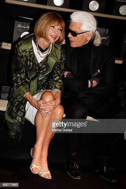 American Vogue editor in chief Anna Wintour chats with designer Karl Lagerfeld at the Karl Lagerfeld Spring/Summer 2009 show during Paris Fashion...