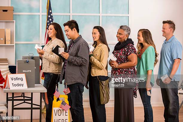 American voters stand in line to cast ballots. November elections.