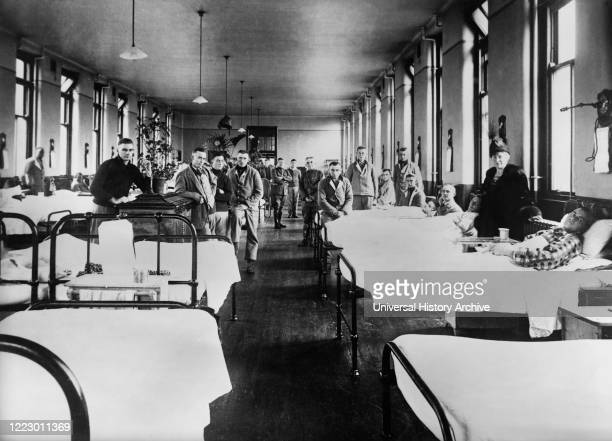 American Ward at Fourth Scottish General Hospital where most Patients are Influenza Cases from incoming Convoys, the Red Cross has a staff of...