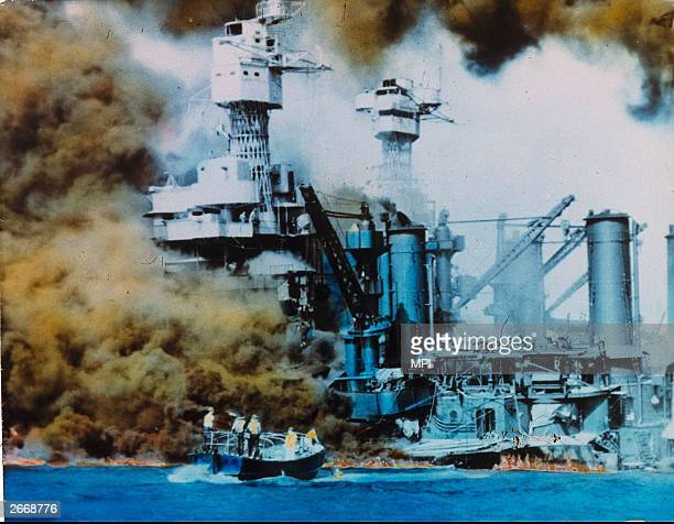 USA warships on fire in Pearl Harbour Oahu Island after a surprise attack by the Japanese which brought America into WW II
