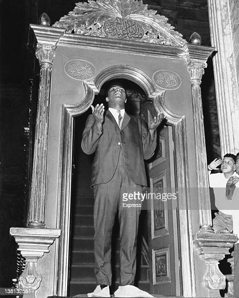 American WBA Heavyweight boxing champion Muhammad Ali standing in the doorway of the Mosque of Muhammad Ali in the Citadel of Cairo Egypt June 1964