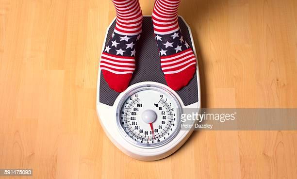 American weighing himself