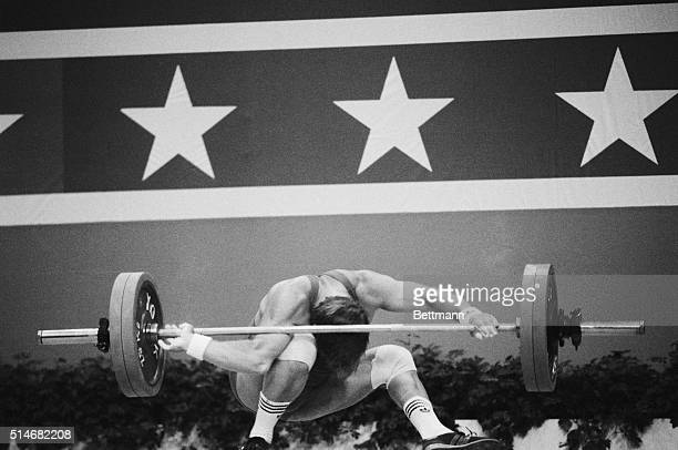 American weightlifter Derrick Crass dislocates his elbow and sprains his right knee as he loses control of the 130Kg weight he is attempting to lift...