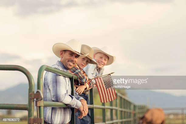 American West Boys dressed Holding USA Flag
