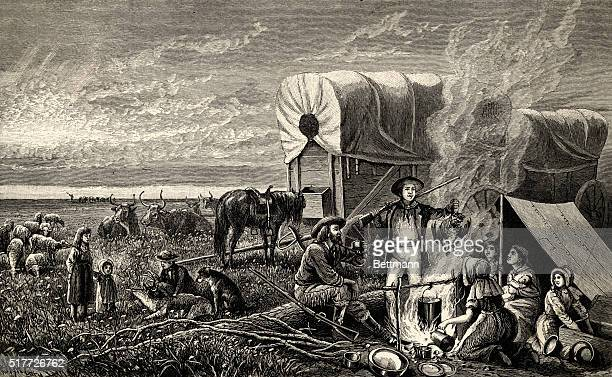 American Westward Expansion 'EMIGRANTS TO THE WEST' prepare a meal on the prairie Undated woodcut