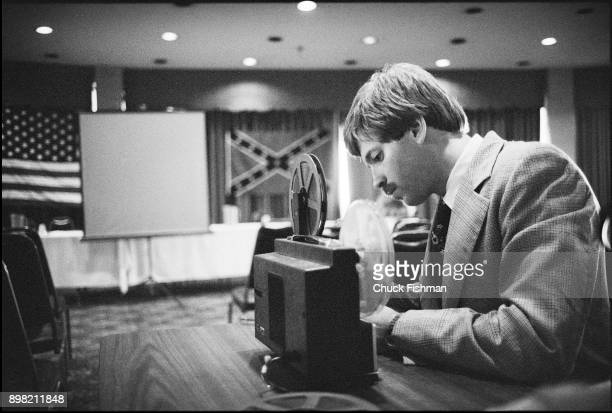 American white supremacist and Grand Wizard of the Ku Klu Klan David Duke sets up a projector for a KKK meeting in the conference room of an...