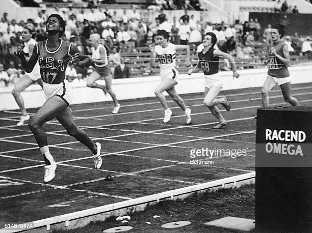 American Wilma Rudolph crosses the finish line in a women's sprint event at the 1960 Summer Olympics in Rome, Italy. September 3, 1960.