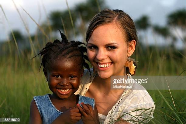 American Woman Holding African Girl