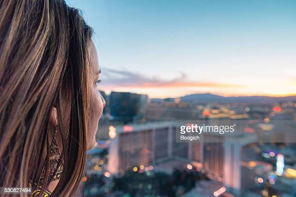 American Woman in 30s Looks at Sunset Las Vegas View
