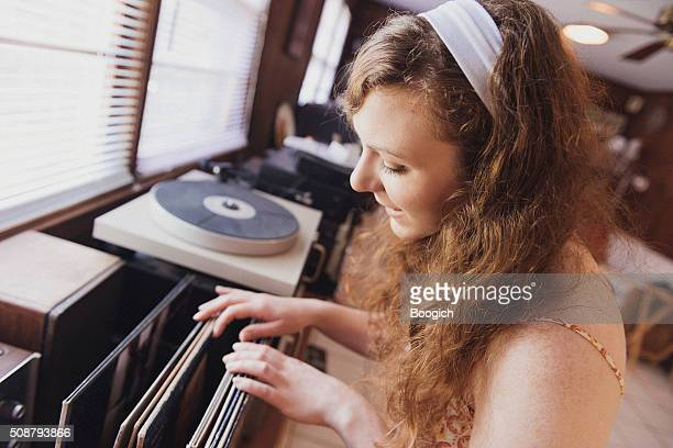 American Woman Sorts Through Vintage Vinyl Record Collection
