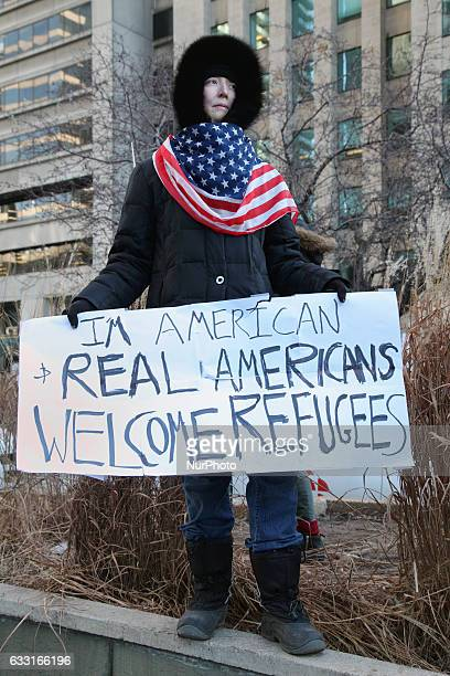 American woman takes part in a massive protest against President Trump's travel ban outside of the US Consulate in downtown Toronto Ontario Canada on...