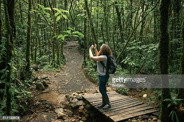 American Woman Takes Pictures on Hike in Costa Rica Rainforest