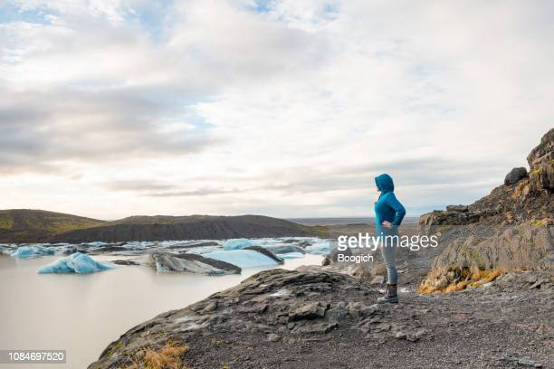 American Woman Traveling Iceland Enjoys Glacier Lagoon Landscape by Skaftafell