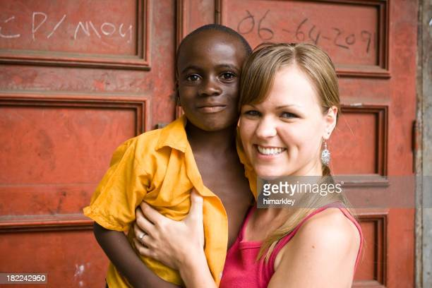 American Woman With African Child