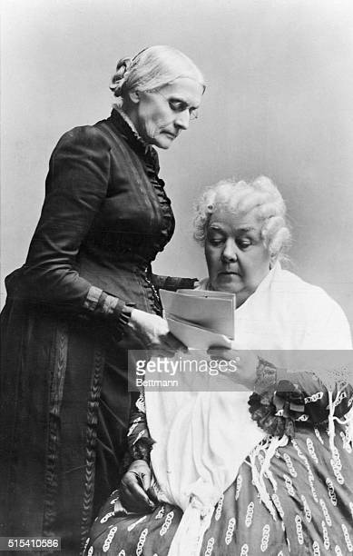 American women's rights pioneers Susan B Anthony standing and Elizabeth Cady Stanton seated read a letter