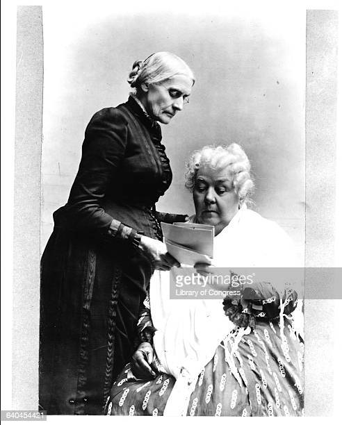 American women's rights pioneers Susan B Anthony standing and Elizabeth Cady Stanton read a letter