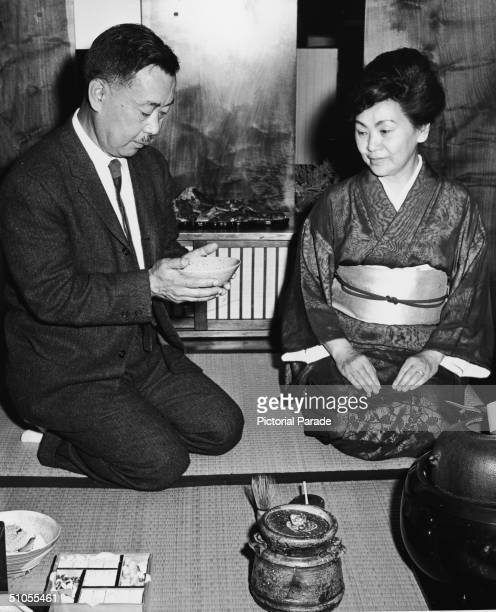 American woodworker and furnature designer George Nakashima lifts a bowl of tea prepared in a traditional tea ceremony by Madama Sowa Sakamoto New...