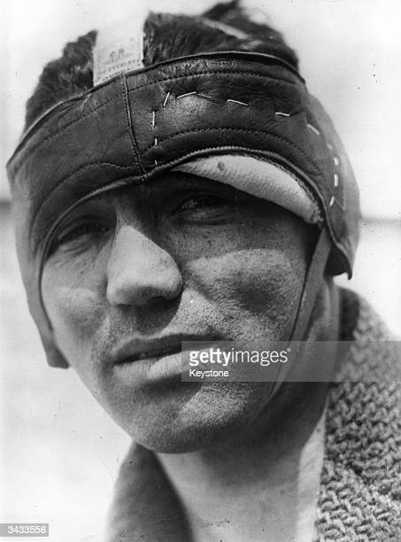 American world champion heavyweight boxer Jack Dempsey taking care of a cut over his eye